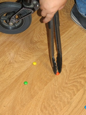 adaptive equipment, kitchen tongs, reachers, M&Ms